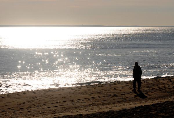 Newbury: Caleb Simmons walks along Plum Island Beach early Friday morning. staff photo