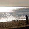 Newbury: Caleb Simmons walks along Plum Island Beach early Friday morning. staff photo