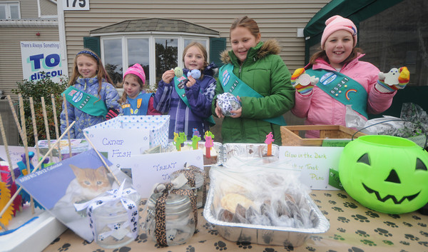 Salisbury: <br /> The Junior Girl Scout Troop #65341 helda fundraiser for the Merrimack River Feline Rescue Society on Saturday at Tom's Discount in Salisbury, for sale  cat products and baked goods and<br /> accepting donations. Their products include homemade crafts that the girls made (cat toys and glow in the dark Halloween pins).  The leaders are contributing handmade glass treat jars and we will be raffling off a set of handmade decorative black cat<br /> silhouettes in honor of both Halloween and National Animal Safety Month.Show are scouts MacKenzie Hamilton, Farrah Gabrian, Glory Trelfa, Taylor Hamilton , and Lexi Cunha, not shown, Sofhia McLellan and Alyssa McEachern. Staff photo