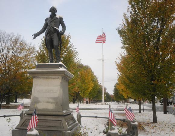 Newburyport: Snow, blue skys, and fall foliage surround the statue of George Washington on teh Mall in Newburyportr Sunday. Jim Vaiknoras/staff photo