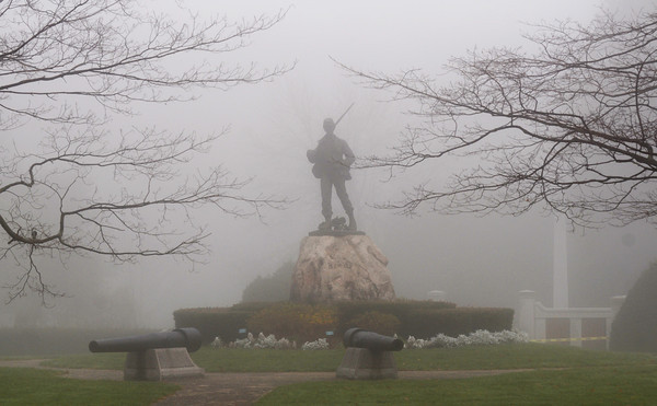 Newburyport: The Civil War monument in Atkinson Common in Newburyport stands in teh thick morning fog Sunday. Jim Vaiknoras/staff photo
