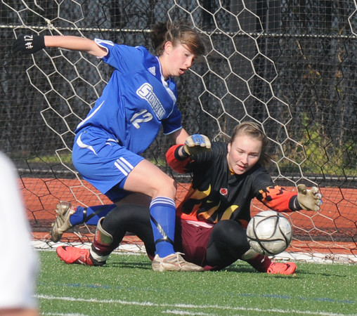 Lynn: Newburyport Lilly Donavan makes a save on Stoneham's Danielle Phalon during the Clipper victory in the North sectional final at Manning Field in Lynn Saturday. Jim Vaiknoras/staff photo