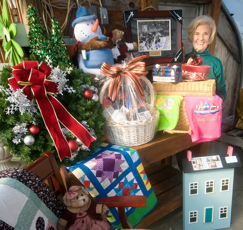 Salisbury: Foubder Betty Cloonan stands with item for the upcoming Santa's Helper auction in Salisbury. staff photo
