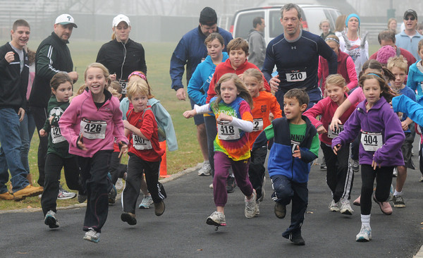 WEST  Newbury: Runner take off in the 1 mile Kids Fun Run at the second annual Pentucket Pride 5K Road Race Sunday morning. Staff photo
