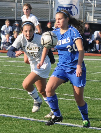 Lynn: Georgetown's Kristin Hogan advances the ball during the Royal's sectional finals game against St Mary's at Manning Field in Lynn Saturday. Jim Vaiknoras/staff photo