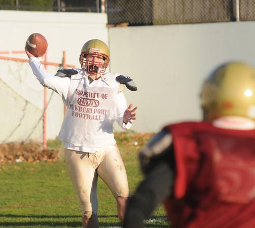 Newburyport: Newburyport quarterback Connor Wile tosses a pass at practice Friday. Jim Vaiknoras/staff photo