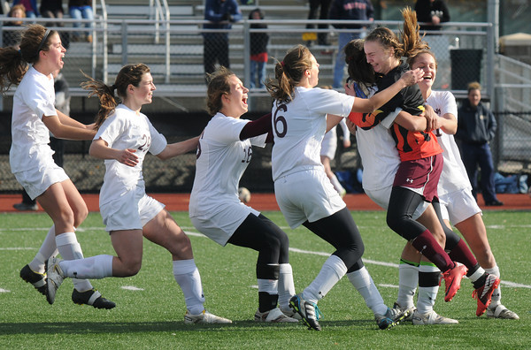 Lynn: Newburyport's girl soccer team celebrate their victory in the North sectional final at Manning Field in Lynn Saturday. Jim Vaiknoras/staff photo