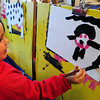 Salisbury: Lilith Barbour, 4, paints a bat in Julie Deschene's preschool class at Salisbury Elementary School on Wednesday afternoon. The younster wants to take the painting home to hang up for Halloween. Bryan Eaton/Staff Photo