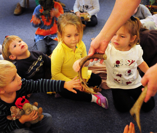 Newburyport: Children at the Newburyport Montessori School touch a deer antler by Joanne Healey on Tuesday morning. The naturalist was teaching children about nature in the autumn season, but the program was moved inside due to rain. Bryan Eaton/Staff Photo