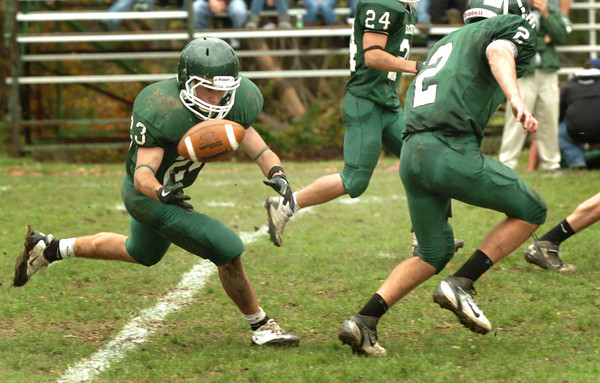 West Newbury: Nick D'Agostino loses the ball briefly while carrying Saturday against Winthrop. Bryan Eaton/Staff Photo