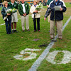 West Newbury: Former Pentucket High School atheletic director Dave Morse speaks at the celebration of 50 years of combined service of former football coach Tom Flaherty and present coach, Steve Hayden. From left, Lisa and Steve Hayden, Tom and Fran Flaherty, athletic director Dan Thornton and Morse. Bryan Eaton/Staff Photo