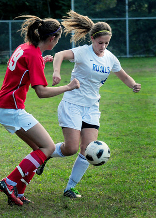 Georgetown: Georgetown's Ashley Mueskes moves past a Masconomet player yesterday afternoon. Bryan Eaton/Staff Photo
