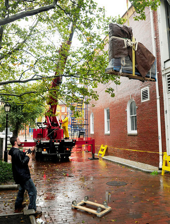 Newburyport:  A crane hoists a Steinway piano into back of the theater of the Firehouse Center yesterday morning. The used, though still pricey, piano replaces a Falcone piano. Bryan Eaton/Staff Photo