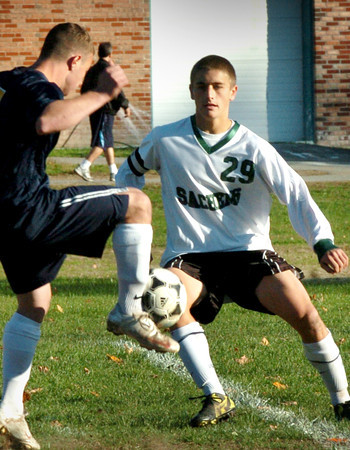 West Newbury: Pentucket's Colin McDonald tries to block a drive by a Lynnfield player yesterday. Bryan Eaton/Staff Photo