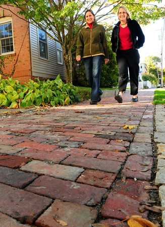 Newburyport: Leah McGavern, left, and Dana Hooper of Marlboro Street in Newburyport along a couple neighbors raised money to buy bricks to have installed. Bryan Eaton/Staff Photo