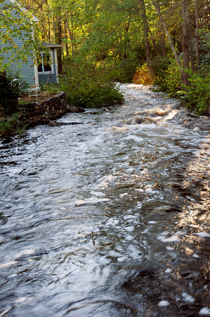 Byfield: The Parker River gushes from recent rains in a view on Main Street in Byfield Center. Bryan Eaton/Staff Photo