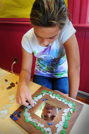 Newburyport: Michelle Thibault, 13, glues sea glass she found to a mirror at the Kelley School Teen Center on Tuesday. The children there are making crafts that they're going to sell at the Newburyport Farmer's Market on October 30. Bryan Eaton/Staff Photo
