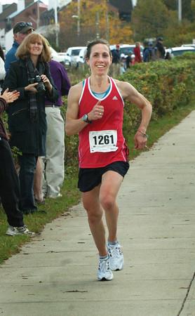 Newburyport: Caroline Bjune of Andover is the first lady to cross the finish in the Greenstride Half Marathon. Bryan Eaton/Staff Photo