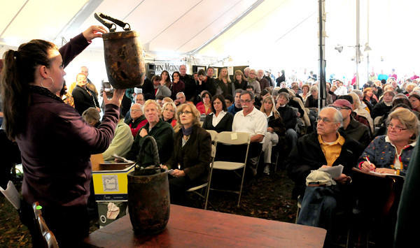 Newbury: A pair of old fire buckets are auctioned off at the Lunt home in Newbury on Saturday. Bryan Eaton/Staff Photo