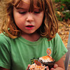 Newburyport: Natalya Berlind, 7, of Newburyport checks out two Halloween-themed cupcakes at the Newburyport Montessori School Parent Associations Bake Sale on Inn Street on Wednesday. Proceeds  from the annual event will be donated to the Pettengill House in Salisbury. Bryan Eaton/Staff Photo