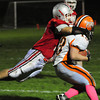 Amesbury: Amesbury defensman Mac Short dives on Ipswich's  Brenden Gallagher last night at Landry Stadium. Bryan Eaton/Staff Photo