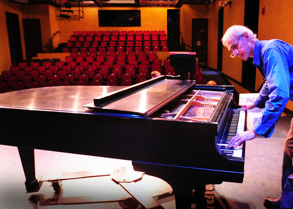 Newburyport: Piano technician Mark Snelling checks out the new Steinway piano, purchased by the Firehouse Center for the Performing Arts, before making adjustments. Bryan Eaton/Staff Photo