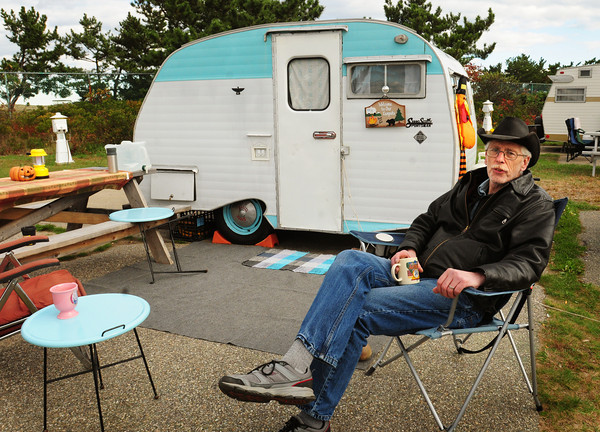 "Salisbury: Don McIver of New Hampton, New Hampshire is one of several ""vintage campers"" at Salisbury Beach State Reservation, sitting outside his restored 1965 Serro Scotty camper. Bryan Eaton/Staff Photo"