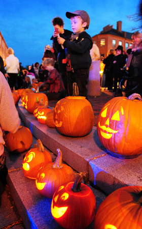 Newburyport: Scores of people showed up at Market Sqaure in downtown Newburyport on Saturday night to see all the lit pumpkins. Many brought their carved pumpkins for Newburyport's First Great Pumpkin Lighting and Stroll. Bryan Eaton/Staff Photo
