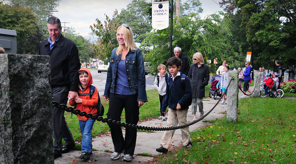 Newburyport: Parents and their children leave Atkinson Common yesterday and head to the Bresnahan School for International Walk to School Day.