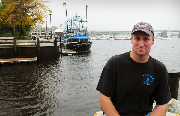 Newburyport: Jim Ford, skipper of the Lisa Ann II, docked in rear. Bryan Eaton/Staff Photo
