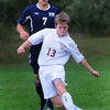 Newburyport: Newburyport Alexander Salah moves past Hamilton-Wenham's Charles Serpa. Bryan Eaton/Staff Photo