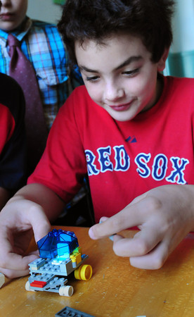 Newburyport: Andre Bonacorsi, 11, works on a space ship using Lego's on Tuesday afternoon. He was at the Kelley School Teen Center. Bryan Eaton/Staff Photo