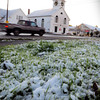 Salisbury: Snow covers the grass across the street from the East Parish Meetinghouse in Salisbury Square yesterday morning. More snow is likely on the way overnight. Bryan Eaton/Staff Photo