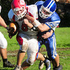 Georgetown: Georgetown's Tom Dillon tackles a Saugus player yesterday afternoon. Bryan Eaton/Staff Photo