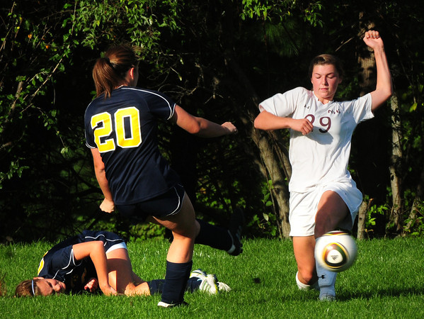 Newburyport: Clipper's Liza Twomey goes against some Lynnfield players. Bryan Eaton/Staff Photo