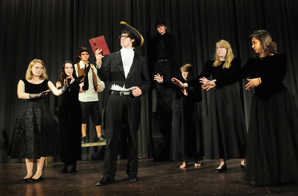 "West Newbury: Cast members of the Pentucket High production of ""Sleepy Hollow"" from left, Shayna Joyce, Melissa Bowden, Colling Schaefer, Liam Leonard-Solis, as Ichabod Crane, Jonathan Acorn, Hannah Lyons, Brooke Snow and Anne Marie Studzinski. Bryan Eaton/Staff Photo"
