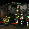 Newbury: Firefighters clean up at the scene of a woodworking shed owned by Bob Walton on Anchor Way in April of 2010. Bryan Eaton/File Photo<br /> , Newbury: Firefighters clean up at the scene of a woodworking shed owned by Bob Walton on Anchor Way in April of 2010. Bryan Eaton/File Photo