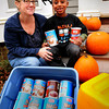 Newburyport: Kristen Fudge of Purchase Street in Newburyport has given out hot cocoa for several years. This year, she and her son, Ashagre Bailsley, 6, are asking for a donation to trick-or-treaters to pay for a hand dug well in Ethiopia. Bryan Eaton/Staff Photo