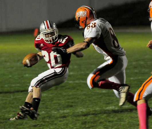 Amesbury: Amesbury captain Jesse Lannon, left, looks to move by Ipswich's Cam Murray. Bryan Eaton/Staff Photo