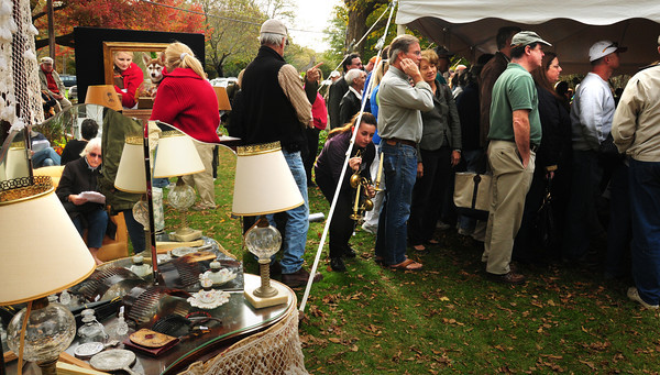 Newbury: Auction-goers look over some items on the Lunt estate lawn, while other watch and participate in the McInnis auction inside the tent. Bryan Eaton/Staff Photo