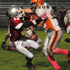 Amesbury: Amesbury's Devlin Gobeil defends against Ipswich running back Peter Moutevelis last night. Bryan Eaton/Staff Photo