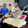 Amesbury: Residents of Heritage Towers in Amesbury make blankets yesterday, from left, Norma King, Barbara Rogers, Lyn Sweeney and Jane Tierney. They were making them for Blankets 4 Kids, a program that provides blankets for needy children in time for the winter season. Bryan Eaton/Staff Photo