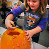 Salisbury: Madyson Haynes, 5, pulls out pumpkins seeds with her hands in Jane Keeler's kindergarten class at Salisbury Elementary School on Thursday. The children got to watch as the seeds were toasted in an electric skillet and then, later were going to carve some pumpkins. Bryan Eaton/Staff Photo