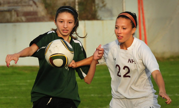 Newburyport: Pentucket's Sam McGrail, left, and Newburyport's Nicole Galer have their eyes on the ball as they try to get control last night. Bryan Eaton/Staff Photo