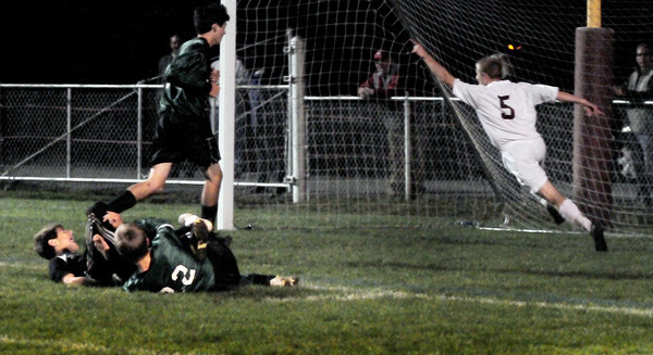 Newburyport: Newburyport's Adam Taxler puts his hand in the air as he scored the first goal of the game against Pentucket in the ALS Cup soccer tournament. Bryan Eaton/Staff Photo