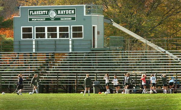 West Newbury: Pentucket High girls soccer team prepare to play against Rockport under a new sign on the pressbox. Bryan Eaton/Staff Photo