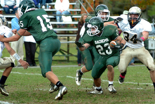 West Newbury: Pentucket's Calvin Wiles (15) clears a Winthrop defender as Nick D'Agostino goes for yardage on a return. Bryan Eaton/Staff Photo