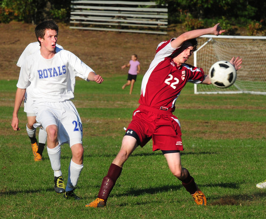 Georgetown: Newburyport's Tom Graham, right, and Georgetown's Kevin Morrisey in action at the West Street Field in Georgetown yesterday afternoon. Bryan Eaton/Staff Photo