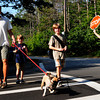 Newburyport: Crossing guard Carol Miller stops traffic as Gary Gorski and his sons, Calvin, 7, left, and Mitchell, 8. with pooch, Fred, cross North Atkinson Street leaving the Bresnahan School. Bryan Eaton/Staff Photo