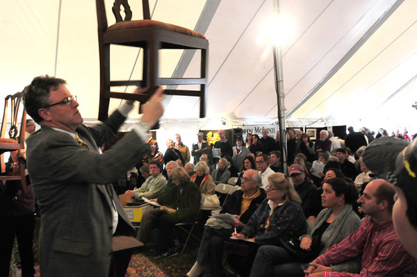 Newbury: A pair of  chairs from the Lunt estate are shown to prospective bidders at the McInnis auction on Saturday. Bryan Eaton/Staff Photo